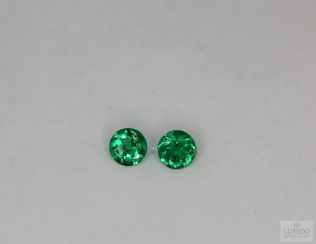 Pair of Emeralds, round cut, 0.42 ct tot.